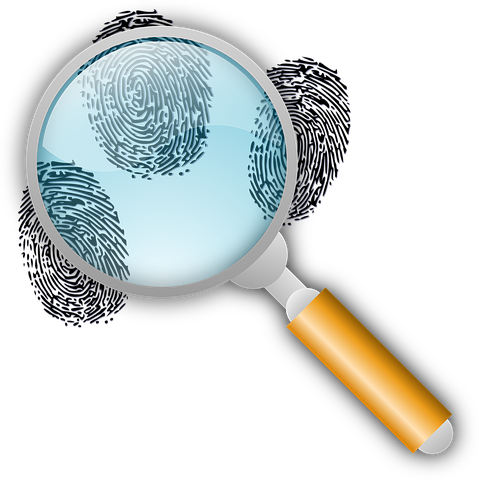 magnifying glass and finger prints
