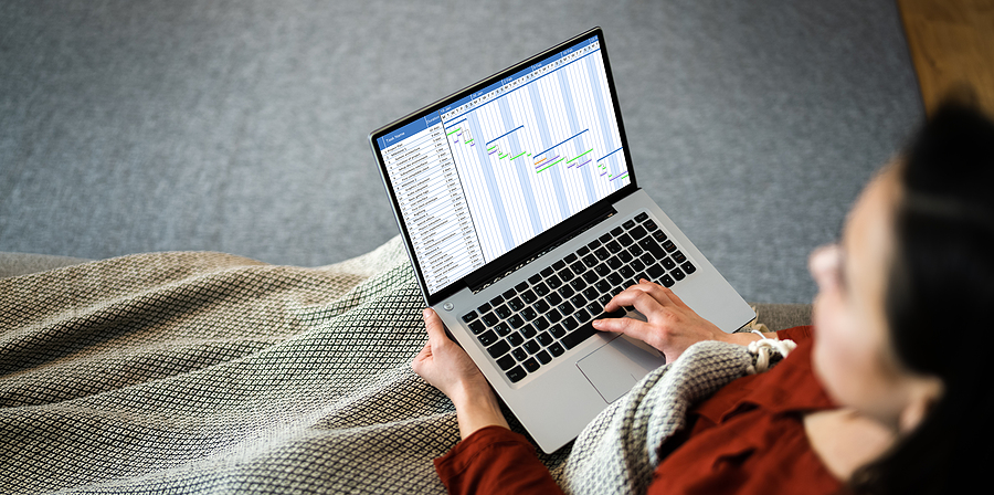 Woman using a time billing software in a laptop