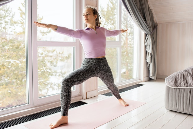 Middle aged woman taking online yoga courses