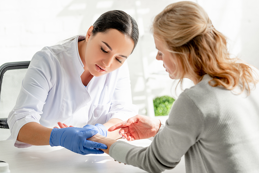Middle-aged woman getting a consultation with the best dermatologist in Melbourne