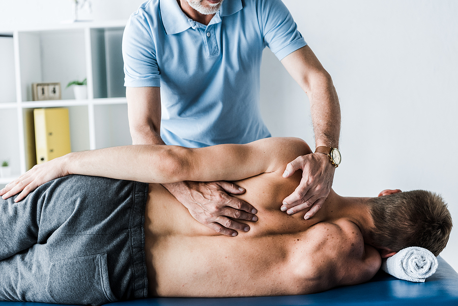 Chiropractor in Norwest treating a male patient